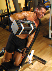 Incline one-arm lateral raise finish