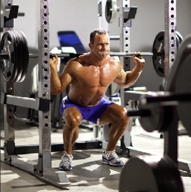 Traditional squats in power rack - Mass Rules: Get Huge With These Moves