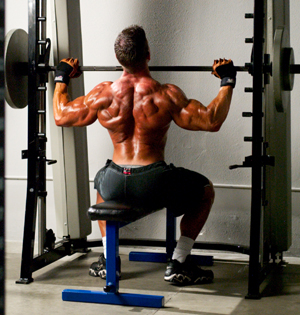 Jonathan Lawson doing negative-accentuated shoulder presses - 3 Fast Fat-to-Muscle Tips to Get You Ripped