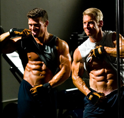 Jonathan and Steve, flexing abs in a mirror - Use Cheat Days During Your Ripping Phase