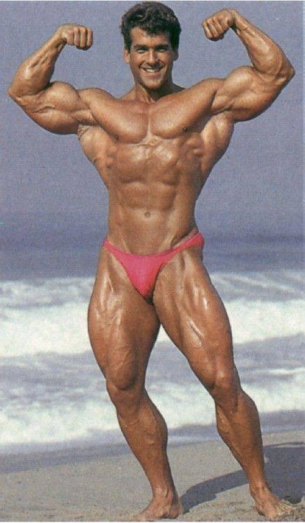 Bob Paris at the beach, double biceps pose