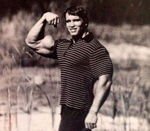 Arnold Schwarzenegger in a polo shirt flexing
