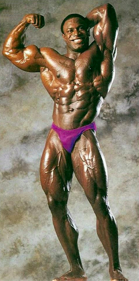Lee Haney full-body pic flexing biceps