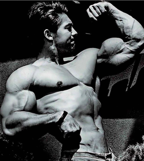 Larry Scott's awesome arms, flexed - black and white
