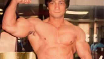 Danilla Padilla in off-season shape flexing his arm, cropped